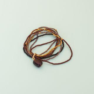 A beautiful story Nirmala Garnet Gold Bracelet